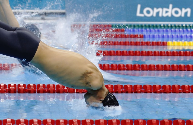 Ukraine's Iaroslav Semenenko dives in to compete in the men's 50m Freestyle - S6 heats during the London 2012 Paralympic Games at the Aquatics Centre in the Olympic Park September 4, 2012. (Luke MacGregor/Reuters)