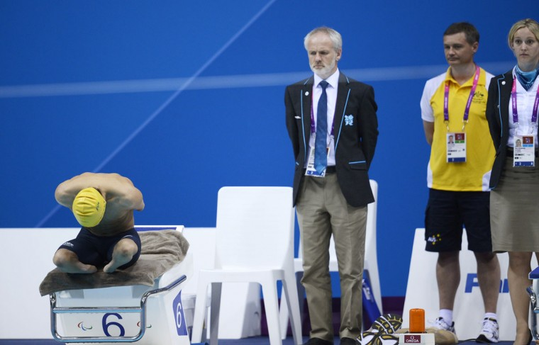 Umpires look on as Australia's Ahmed Kelly prepares on the starting blocks for the Men's 50 metres Breaststroke Final SB3 category during the London 2012 Paralympic Games at the Aquatics Centre in the Olympic Park in east London on September 3, 2012. (Adrian Dennis/AFP/Getty Images)