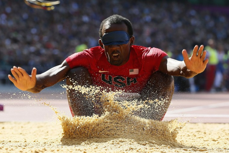 Elexis Gillette of the U.S. competes in the men's Long Jump Final F11 during the London 2012 Paralympic Games at the Olympic Stadium in London, September 4, 2012. In the F11 category the competitors are completely blind and have a guide when competing. (Stefan Wermuth/Reuters)