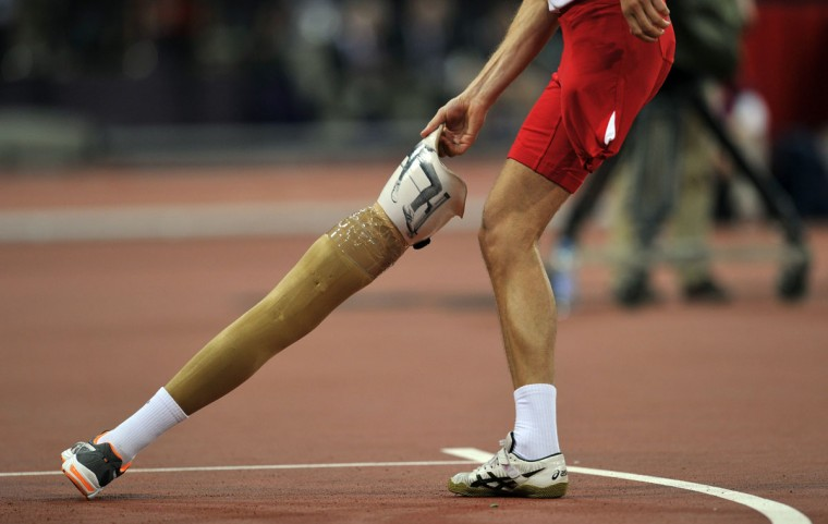 Poland's Lukasz Mamczarz picks up his prosthetic leg while competing in the Men's High Jump F42 Final athletics event during the London 2012 Paralympic Games at the Olympic Stadium in east London, on September 3, 2012. (Glyn Kirk/AFP/Getty Images)