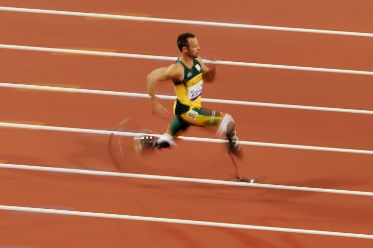 Oscar Pistorius of South Africa breaks the world record with a time of 21.30 as he competes in the Men's 200m - T44 heats on day 3 of the London 2012 Paralympic Games at Olympic Stadium on September 1, 2012 in London, England. (Scott Heavey/Getty Images)