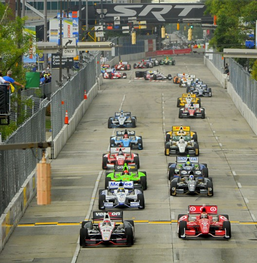 The green flag starts the race, with Will Power (left) and Scott Dixon (right) leading the pack.