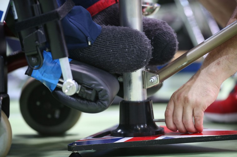 Jacob Thomas of Great Britain uses his feet to aim his ramp during the BC3 Mixed Pairs Boccia pool match against Greece on day 4 of the London 2012 Paralympic Games at ExCel on September 2, 2012 in London, England. Greece won the match 5-0. (Peter Macdiarmid/Getty Images)