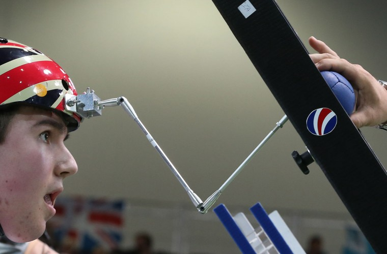 Jacob Thomas of Great Britain uses a helmet mounted attachment to launch a ball from the ramp during the BC3 Mixed Pairs Boccia pool match against Greece on day 4 of the London 2012 Paralympic Games at ExCel on September 2, 2012 in London, England. (Peter Macdiarmid/Getty Images)