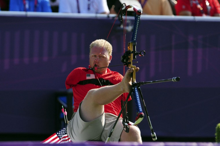 Matt Stutzman (USA) shoots in the semifinal round of the men's compound - open during the London 2012 Paralympic Games at Royal Artillery Barracks on September 3, 2012. (Andrew Fielding/US Presswire)
