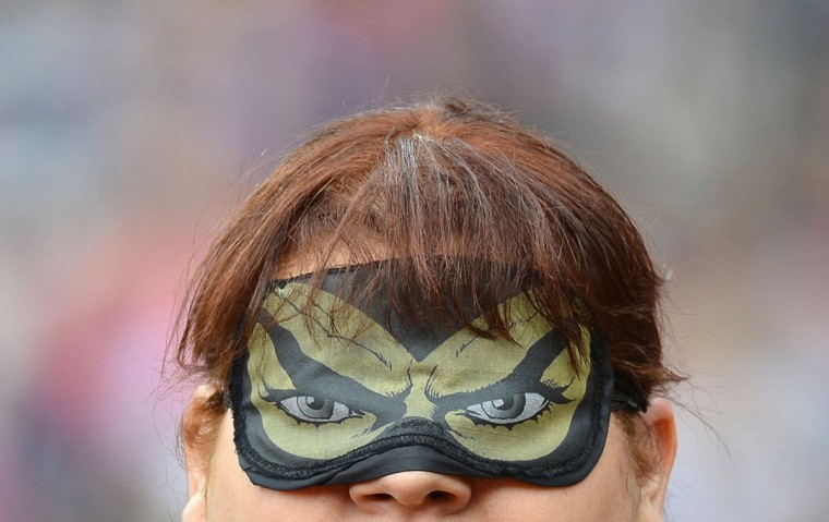 Assunta Legnante of Italy wears an eye mask depicting a pair of eyes during the Women's Discus F11/12 classification final at the Olympic Stadium during the London 2012 Paralympic Games September 1, 2012. In the F11 category the competitors are completely blind and have a guide when competing. (Toby Melville/Reuters)