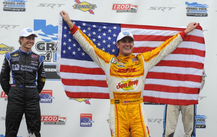 Ryan Hunter-Reay, the 2012 Grand Prix of Baltimore, celebrates his victory while second-place finisher Ryan Briscoe, left, looks on.