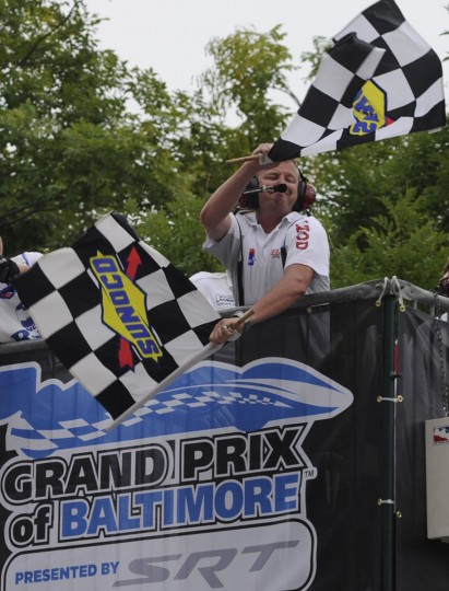 The checkered flag is waved as Ryan Hunter-Reay crosses the finish line to win the Grand Prix of Baltimore.