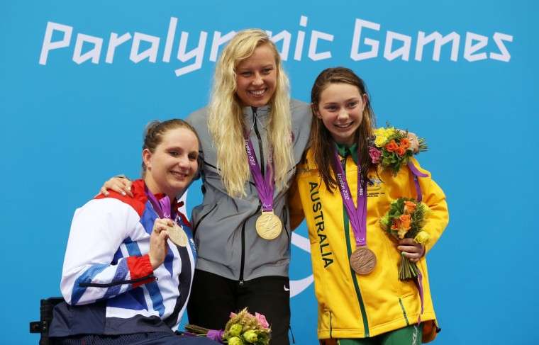 (L-R) Silver medallist Heather Frederiksen of Great Britain, gold medallist Jessica Long of the United States and bronze medallist Maddison Elliott of Australia pose on the podium during the medal ceremony for the Women's 400m Freestyle - S8 Final on day 2 of the London 2012 Paralympic Games at Aquatics Centre on August 31, 2012 in London, England. (Clive Rose/Getty Images)