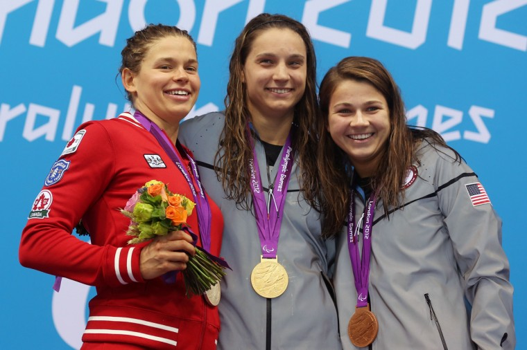 Silver medalist (from left) Valerie Grand-Maison of Canada, gold medalist Kelley Becherer of the United States and bronze medalist Rebecca Anne Meyers of the United States pose on the podium during the medal ceremony for the Women's 100m Freestyle - S13 final on day 4 of the London 2012 Paralympic Games at Aquatics Centre on September 2, 2012 in London, England. (Clive Rose/Getty Images)