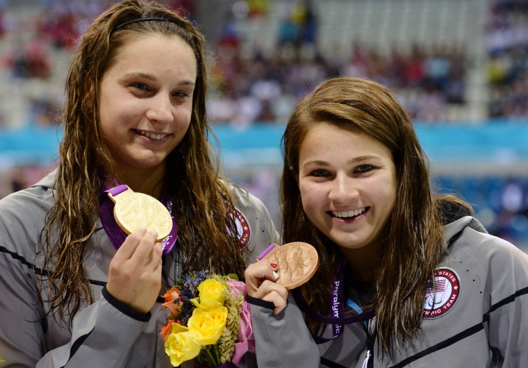 Gold medalist Kelley Becherer of the United States and bronze medalist Rebecca Anne Meyers of the United States pose following the medal ceremony for the Women's 100m Freestyle - S13 final on day 4 of the London 2012 Paralympic Games at Aquatics Centre in London, England. (Christopher Lee/Getty Images)