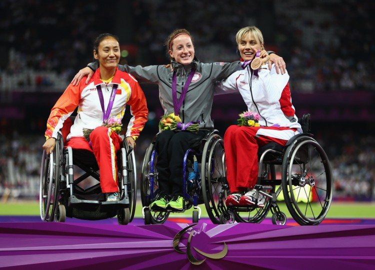 Silver medalist (from left) Hongjiao Dong of China, Gold medalist Tatyana Mcfadden of the United States and bronze medalist Edith Wolf of Switzerland pose on the podium during the medal ceremony for the Women's 400m - T54 Final on day 5 of the London 2012 Paralympic Games at Olympic Stadium in London, England. (Michael Steele/Getty Images)