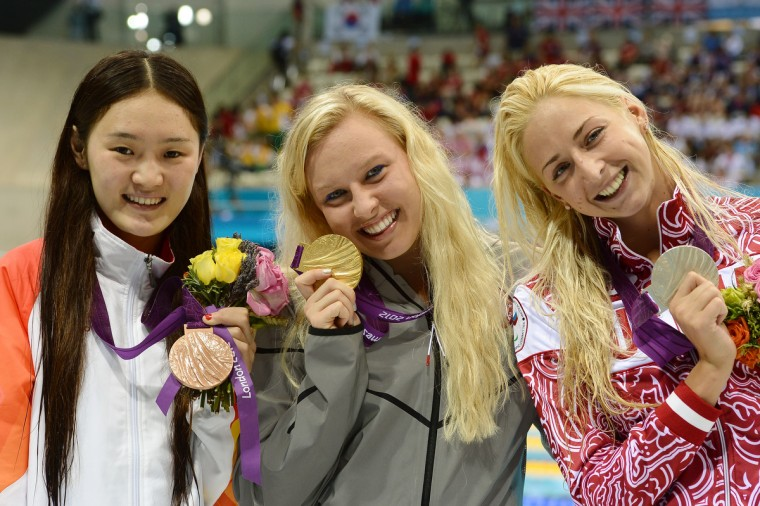 Silver medalist Olesya Vladykina of Russia (R-L), gold medalist Jessica Long of the United States and bronze medalist Shengnan Jiang of China pose on the podium during the medal ceremony for the Women's 200m Individual Medley - SM8 Final on day 7 of the London 2012 Paralympic Games at Aquatics Centre on September 5, 2012 in London, England. ( Christopher Lee/Getty Images)