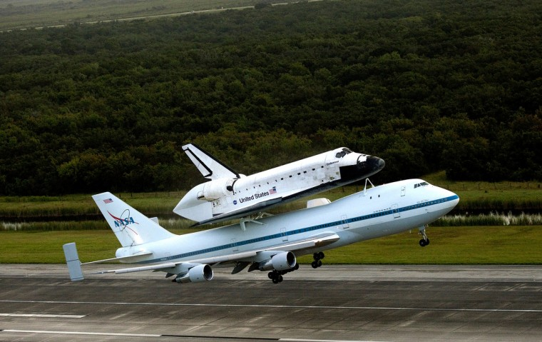 NASA's Shuttle Carrier Aircraft, or SCA, with the space shuttle Endeavour mated on top takes off from the Shuttle Landing Facility runway at NASA Kennedy Space Center on September 19, 2012 in Cape Canaveral, Florida. (Kim Shiflett/NASA)