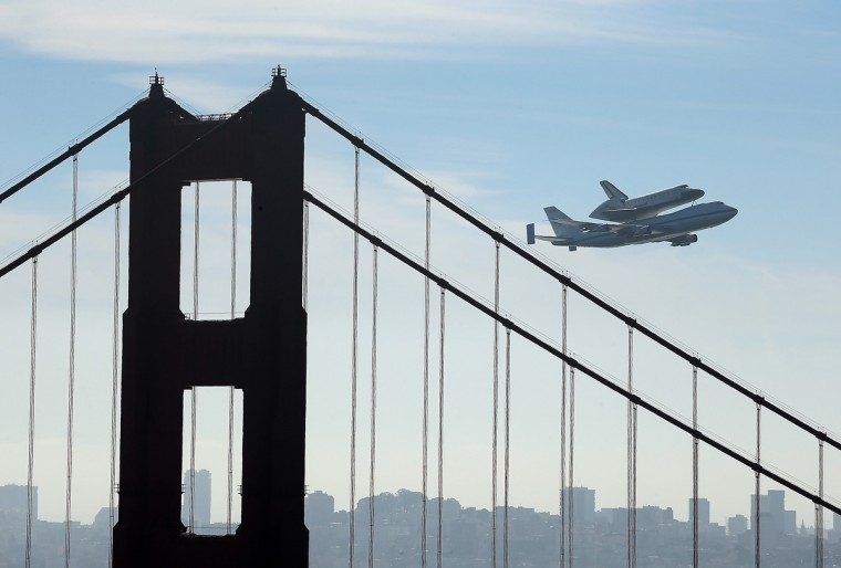 The Space Shuttle Endeavour flies on top of a modified 747 jumbo jet over the Golden Gate Bridge and Sutro Tower as it travels to Los Angeles. The Space Shuttle Endeavour did a 4-1/2 hour tour over California landmarks before heading to Los Angeles International Airport where it will be prepared to be moved to its new permanent home at the California Science Center in downtown Los Angeles. The shuttle will be on public display starting October 30. (Justin Sullivan/Getty Images)