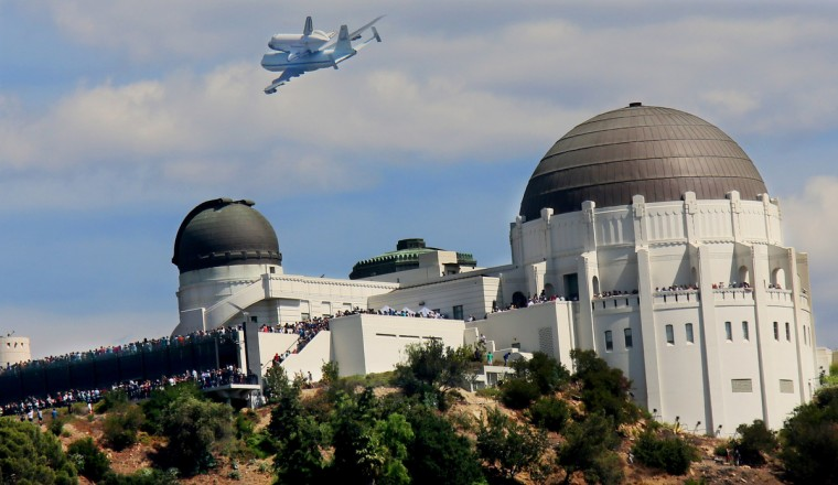 The space shuttle Endeavour, on top of NASA's Shuttle Carrier Aircraft or SCA, flies over the Griffith Park Observatory in Los Angeles, California. The space shuttle Endeavour did a 4-1/2 hour tour over California landmarks before heading to Los Angeles International Airport where it will be prepared to be moved to its new permanent home at the California Science Center in downtown Los Angeles. The shuttle will be on public display starting October 30. (Sandy Huffaker/Getty Images)