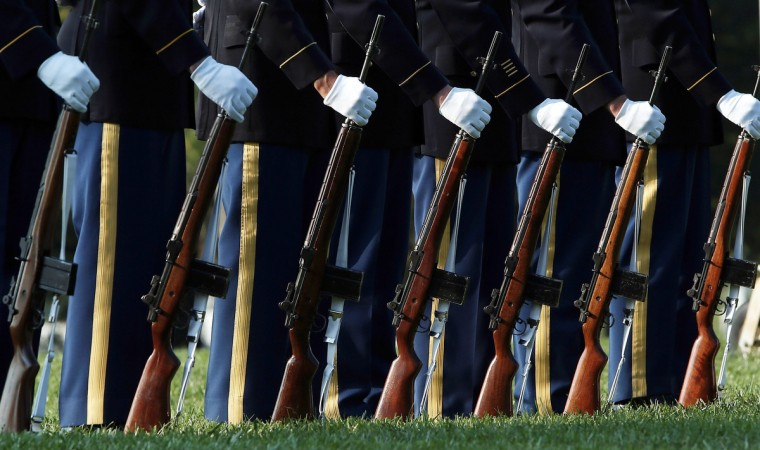 A U.S. Army firing party stands ready during the burial service of U.S. Army Chief Warrant Officer 2 Thalia S. Ramirez at Arlington National Cemetery in Arlington, Virginia. Ramirez died September 5 in Logar Province, Afghanistan, from injuries suffered when a OH-58D Kiowa helicopter crashed. (Win McNamee/Getty Images)