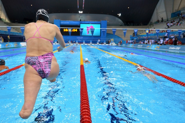 US swimmer Jessica Long enters the swimming pool during a training session at the London 2012 Paralympic Games at the Olympic Park's Aquatics Centre in east London, on August 31, 2012. (Ben Stansall/GettyImages)
