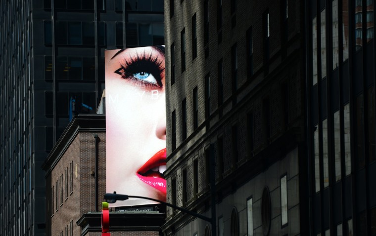 A billboard advertising cosmetic products is set in front of an office building in Times Square in New York. (Emmanuel Dunand/GettyImages)