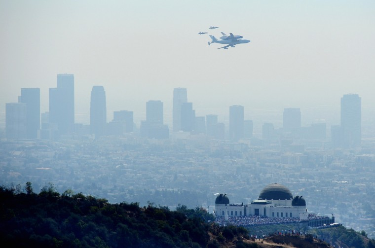 The Space Shuttle Endeavour, mounted atop NASA's modified Boeing 747, flies near the Griffith Park Observatory in Los Angeles on its final flight. (Joe Klamar/GettyImages)