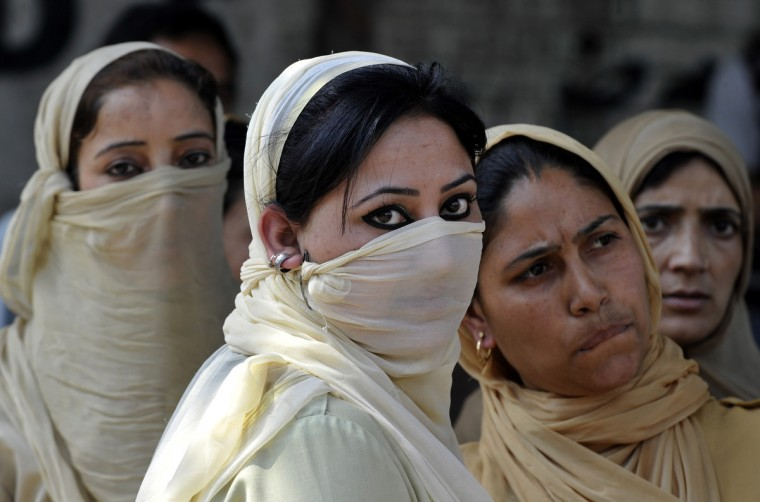 Indian policewomen watch Kashmiri nursing students during a protest against their exam results in Srinagar. Indian police used batons to disperse a sit-in protest by female Kashmiri nursing students and detained some half a dozen during a protest against the results of their third year examinations which most of the students failed. (Tauseef Mustafa/GettyImages)