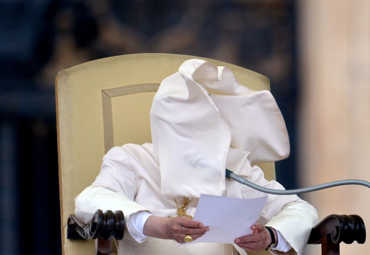 A gust of wind blows Pope Benedict XVI's collar into his face during his weekly general audience in Saint-Peter's square at the Vatican. (Vincenzo Pinto/GettyImages)