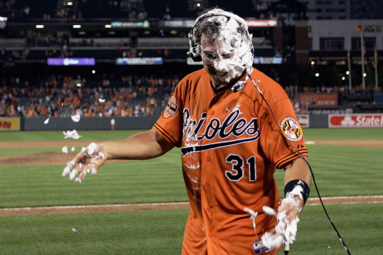 July 14, 2012: Catcher Taylor Teagarden is interviewed after teammates doused him with shaving cream following the Orioles' 8-6 win over the Tigers on July 14, 2012. Teagarden hit the game-winning home run in the 13th inning. (Rob Carr/Getty Images)