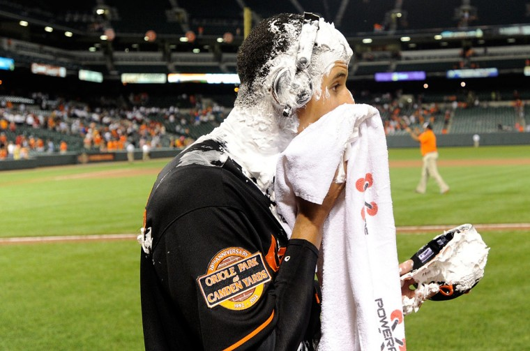 Aug. 10, 2012: The Orioles' Manny Machado cleans up after getting a shaving cream pie to the face following a 7-1 victory against the Kansas City Royals at Camden Yards. Machado hit the first two home runs of his career in the game. (Greg Fiume/Getty Images)