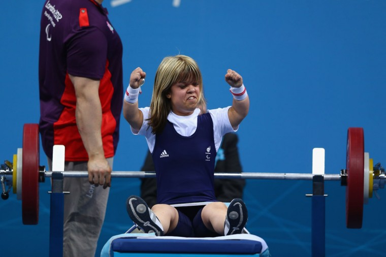 Zoe Newson of Great Britain celebrates a successful lift on her way to winning the bronze medal in the Women's 40kg Powerlifting on day 1 of the London 2012 Paralympic Games at ExCel on August 30, 2012 in London, England. (Michael Steele/Getty Images)
