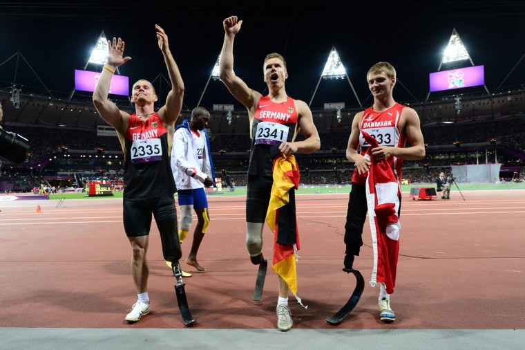 Wojtek Czyz (L) and Markus Rehm (C) of Germany and Daniel Jorgensen (R) of Denmark celebrate after winning medals in the Men's Long Jump - F42/44 Final on Day 2 at the London 2012 Paralympic Games at the Olympic Stadium on August 31, 2012 in London, England. (Justin Setterfield/Getty Images)