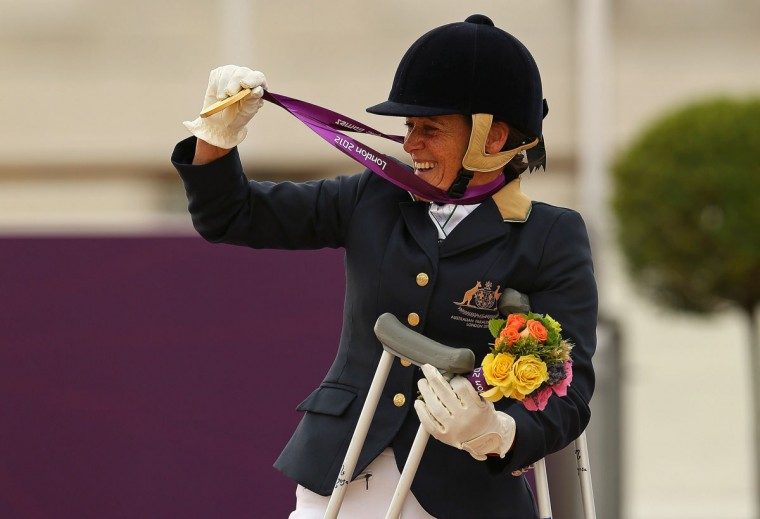 Joann Formosa of Australia celebrates winning the Gold Medal in the Equestrian Individual Freestyle Test - Grade Ib on day 3 of the London 2012 Paralympic Games at Greenwich Park on September 1, 2012 in London, England. (Mike Ehrmann/Getty Images)