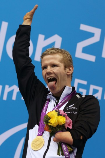 Gold medalist Cameron Leslie of New Zealand poses on the podium during the medal ceremony for the Men's 150m Individual Medley - SM4 final on day 4 of the London 2012 Paralympic Games at Aquatics Centre on September 2, 2012 in London, England. (Clive Rose/Getty Images)