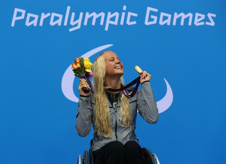 Gold medalist Mallory Weggemann of the United States poses on the podium during the medal ceremony for the Women's 50m Freestyle - S8 final on day 4 of the London 2012 Paralympic Games at Aquatics Centre on September 2, 2012 in London, England. (Clive Rose/Getty Images)