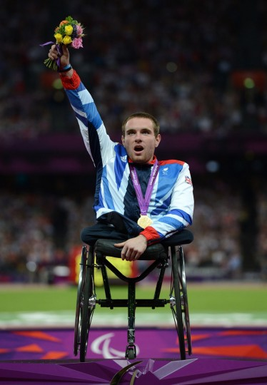 Gold medalist Mickey Bushell of Great Britain poses on the podium during the medal ceremony for the Men's 100m - T53 Final on day 5 of the London 2012 Paralympic Games at Olympic Stadium on September 3, 2012 in London, England. (Gareth Copley/Getty Images)