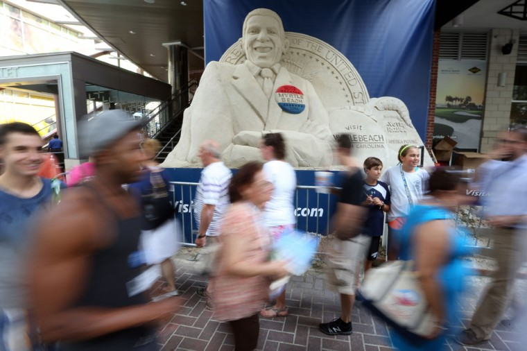 People walk past a sand sculpture of Barack Obama along the streets of uptown Charlotte ahead of the Democratic National Convention on September 3, 2012. (Streeter Lecka/Getty Images)