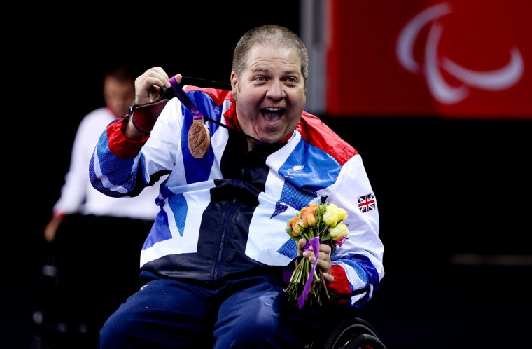 Paul Davies of Great Britain celebrates with his medal after winning bronze during the Men's Singles Table Tennis - Class 1 on day 5 of the London 2012 Paralympic Games at the ExCel on September 03, 2012 in London, England. (Ben Hoskins/Getty Images)
