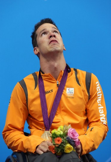 Gold medalist Michael Schoenmaker of Netherlands poses on the podium during the medal ceremony for the Men's 50m Breaststroke - SB3 final on day 5 of the London 2012 Paralympic Games at Aquatics Centre on September 3, 2012 in London, England. (Clive Rose/Getty Images)