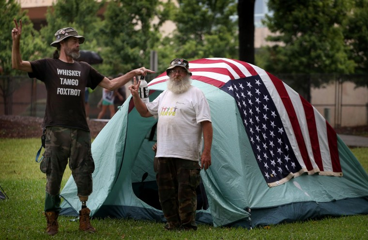 Ed Hunt (L) and Forrest Bibbee stand outside a tent in Marshall Park where protestors in town for the Democratic National Convention have erected a tent city September 3, 2012 in Charlotte, North Carolina. (Scott Olson/Getty Images)