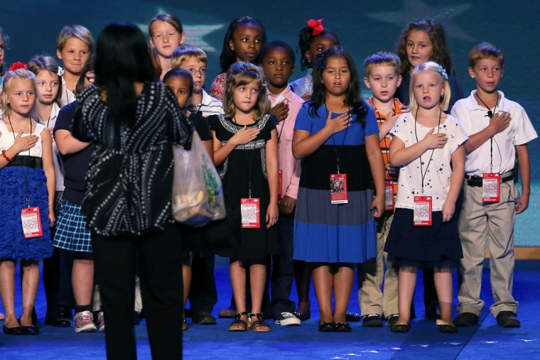Students of the 3rd grade class at W.R. Odell Elementary School of Concord, North Carolina do a walkthrough of the Pledge of Allegiance on stage during Day 1 of the Democratic National Convention at Time Warner Cable Arena on September 4, 2012. (Alex Wong/Getty Images)