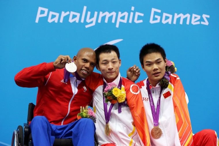 (L-R) Silver medalist Lorenzo Perez Escalona of Cuba, gold medalist Qing Xu of China and bronze medalist Tao Zheng of China pose on the podium during the medal ceremony for the Men's 50m Freestyle - S6 final on day 6 of the London 2012 Paralympic Games at Aquatics Centre on September 4, 2012 in London, England. (Clive Rose/Getty Images)