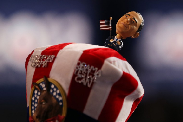 A person wears a hat with a bobblehead of Democratic presidential candidate, U.S. President Barack Obama during day one of the Democratic National Convention on September 4, 2012. (Justin Sullivan/Getty Images)