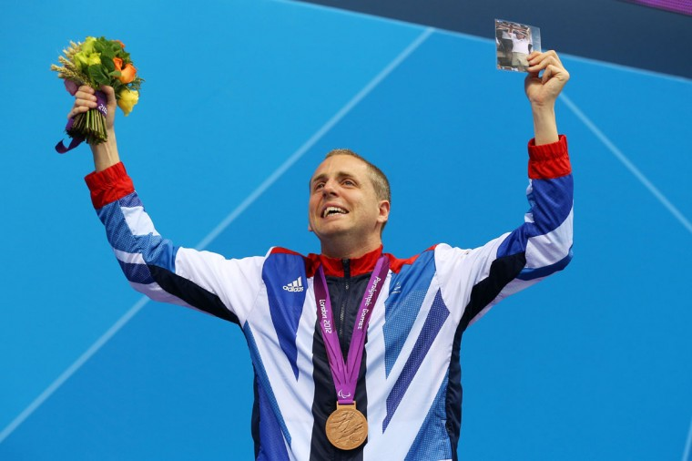 Bronze medalist Matthew Walker of Great Britain poses following the medal ceremony for the Men's 50m Freestyle - S7 final on day 6 of the London 2012 Paralympic Games at Aquatics Centre on September 4, 2012 in London, England. (Clive Rose/Getty Images)