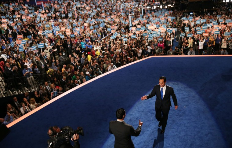 San Antonio Mayor Julian Castro (R) leaves the stage and greets his brother State Rep. Joaquin Castro (D-TX) after giving the keynote address on stage during day one of the Democratic National Convention at Time Warner Cable Arena on September 4, 2012 in Charlotte, North Carolina. The DNC that will run through September 7, will nominate U.S. President Barack Obama as the Democratic presidential candidate. (Win McNamee/Getty Images)