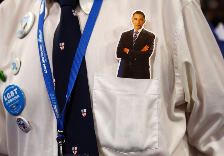 A person has a cutout of Democratic presidential candidate, U.S. President Barack Obama in his pocket during day one of the Democratic National Convention at Time Warner Cable Arena on September 4, 2012 in Charlotte, North Carolina. (Joe Raedle/Getty Images)