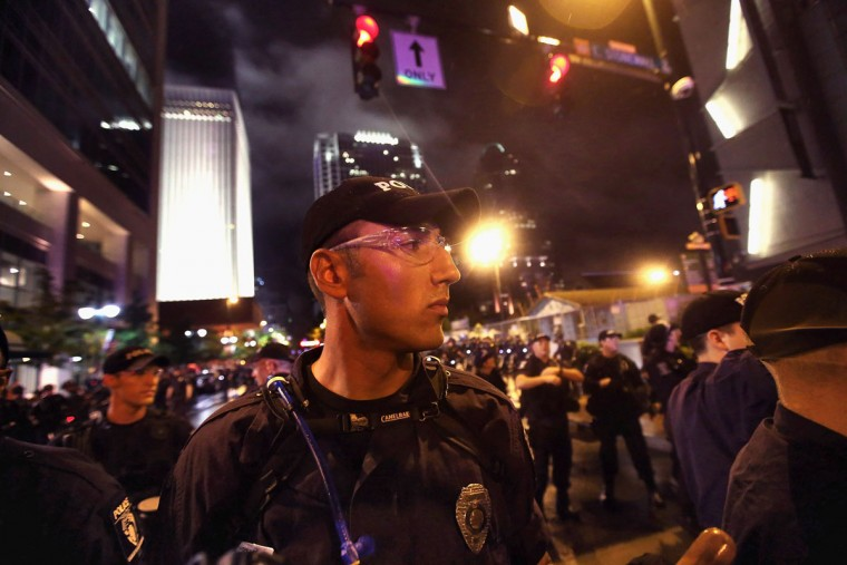 Police face off with protesters during a march on the Democratic National Convention September 4, 2012 in Charlotte, North Carolina. Police officers from around the country are in Charlotte to provide security for the Democratic National Convention which begins today and runs through Thursday. (Scott Olson/Getty Images)