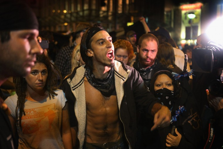 A protestor yells at police during a march on the Democratic National Convention September 4, 2012 in Charlotte, North Carolina. (Scott Olson/Getty Images)