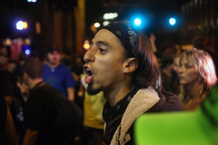 A protestor yells at police during a standoff at the Democratic National Convention September 4, 2012 in Charlotte, North Carolina. (Scott Olson/Getty Images)