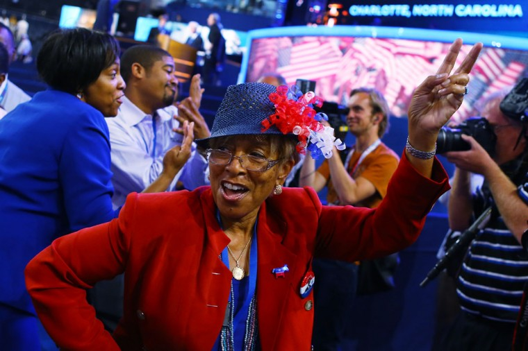 People dance to music on the floor during day two of the Democratic National Convention at Time Warner Cable Arena in Charlotte, North Carolina. (Joe Raedle/Getty Images)