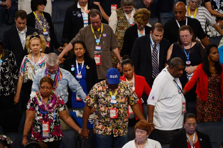 People pray during the invocation during day two of the Democratic National Convention at Time Warner Cable Arena in Charlotte, North Carolina. (Kevork Djansezian/Getty Images)