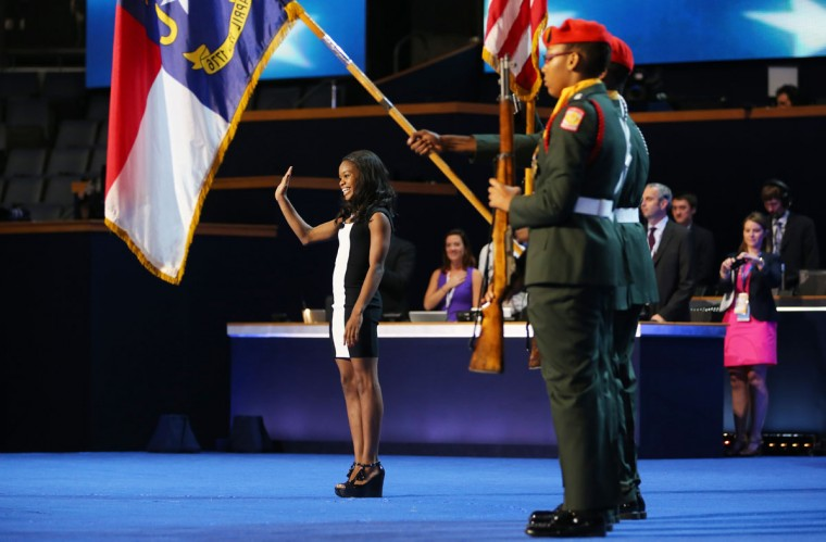 Olympic gymnast Gabby Douglas leads the Pledge of Allegiance as the West Charlotte High School ROTC present the colors during day two of the Democratic National Convention at Time Warner Cable Arena in Charlotte, North Carolina. (Joe Raedle/Getty Images)